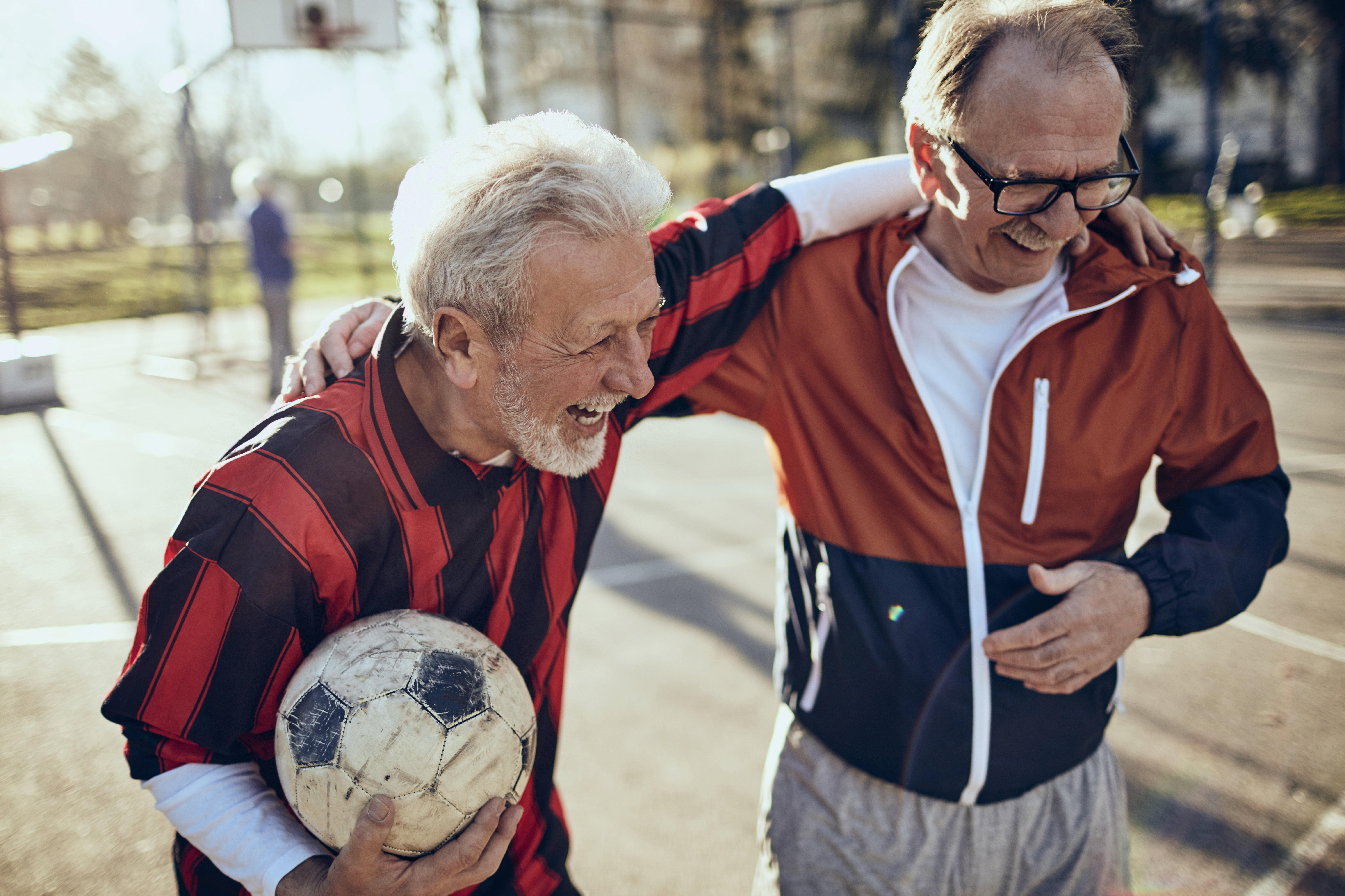 two-men-laughing-with-soccer-ball